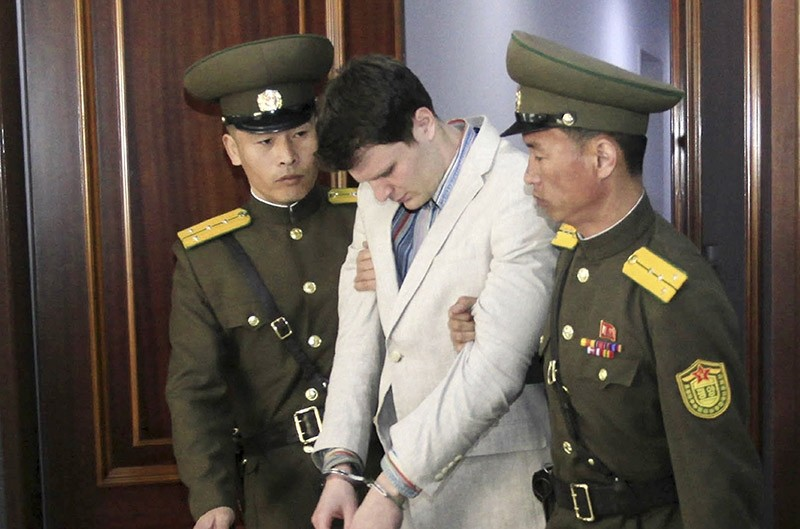 In this March 16, 2016, file photo, American student Otto Warmbier, center, is escorted at the Supreme Court in Pyongyang, North Korea. Warmbier (AP Photo)