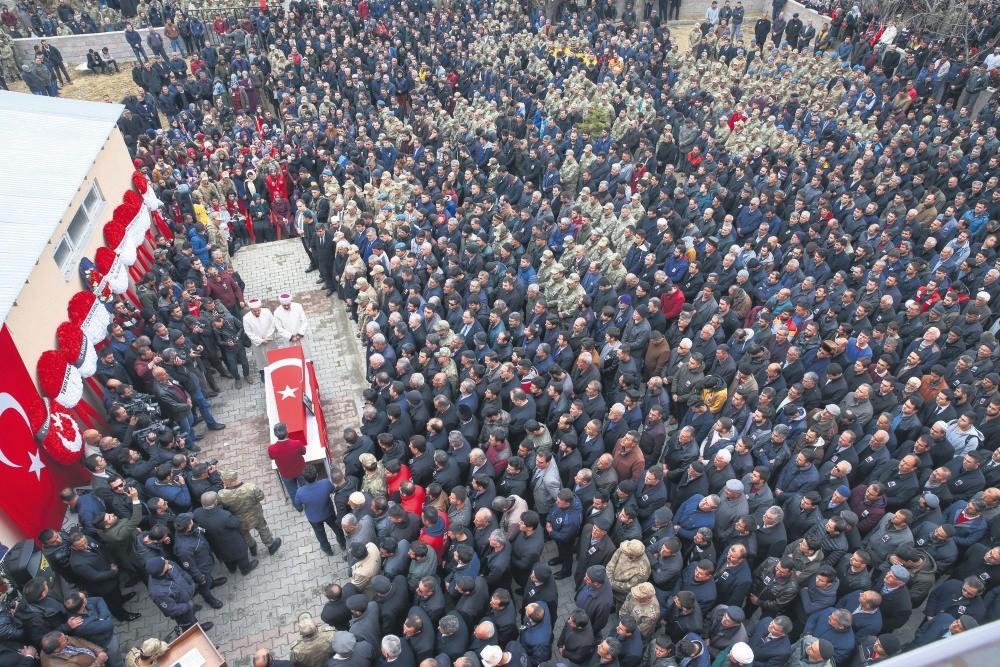 People attend the funeral of Ru0131dvan u00c7evik, one of eight soldiers killed in Afrin, in his hometown Erciu015f in the eastern province of Van.