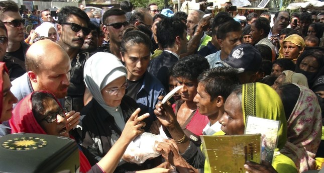 First lady Emine Erdoğan, with her son Bilal Erdoğan, interact with Rohingya Muslims at the Kutupalong refugee camp, Bangladesh, Sept. 7.