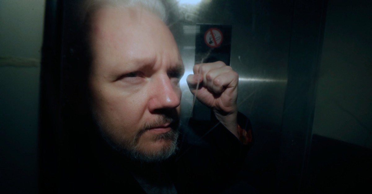 In this May 1, 2019, file photo, WikiLeaks founder Julian Assange puts his fist up as he is taken from court in London. (AP Photo)