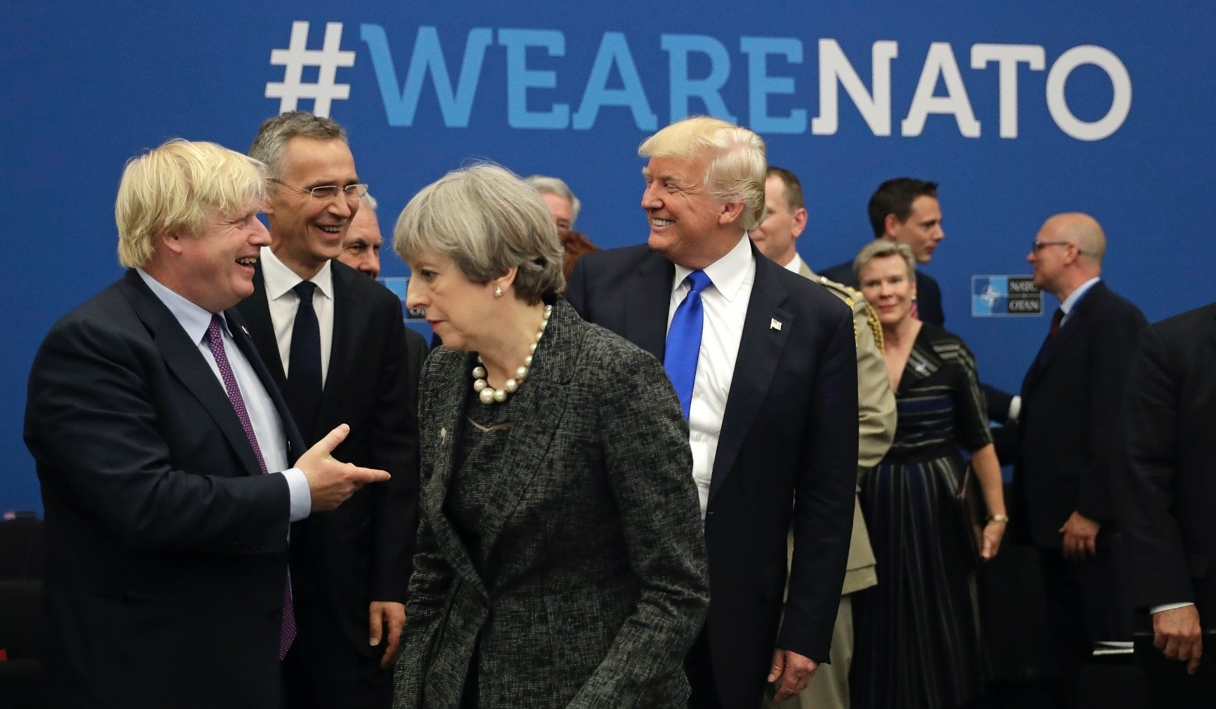U.S. President Donald Trump jokes with then-Foreign Minister Boris Johnson of the U.K., as British Prime Minister Theresa May walks past during the annual summit at NATO headquarters, Brussels,  2017.