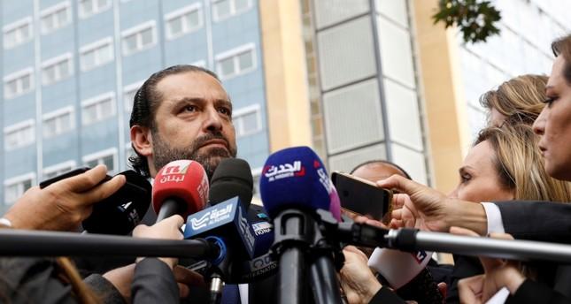 سعد الحريري ، نجل رئيس الوزراء اللبناني الأسبق رفيق الحريري متحدثا إلى الصحافة أمام المحكمة الخاصة بلبنان في لاهاي، يوم الاثنين 11 سبتمبر (AP)