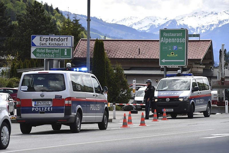 Austrian police have closed the street to Erpfendorf in the Austrian province of Tyrol, Friday May 12, 2017, after a person has been taken hostage during a bank robbery. Further details weren't immediately available. (AP Photo)