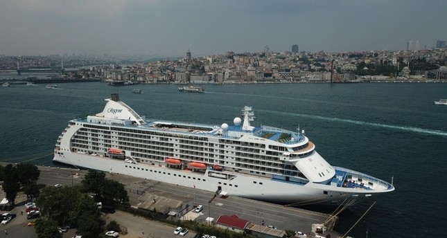 The 10-story Regent Seven Seas Voyager, carrying 750 passengers, is the first cruiser to dock in Istanbul in four years, June 6, 2019.