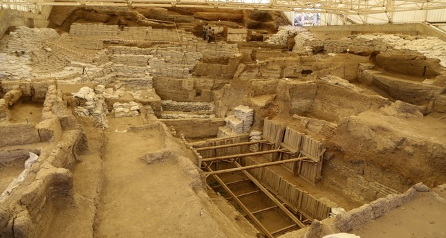 Archaeologists working at the ancient site conduct research in various fields like the social life, food and clothing of the people who used to live in 9,000-year-old adobe houses built adjacently with doors in the roofs.