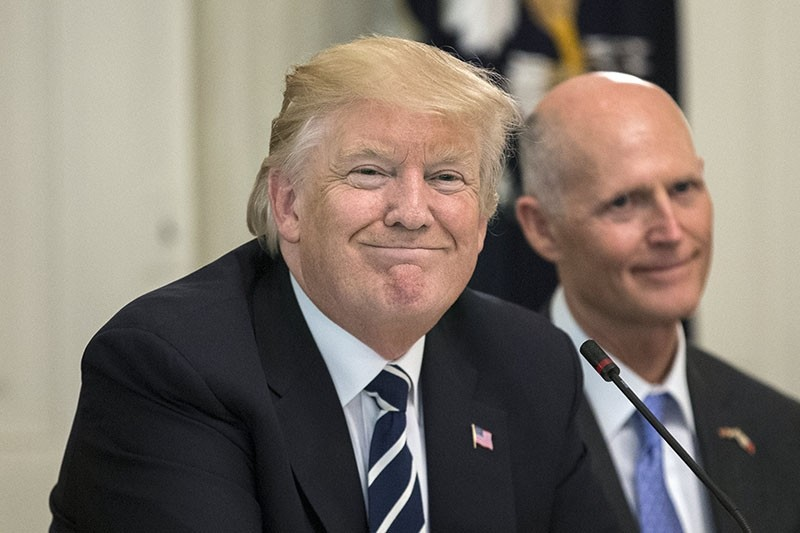 US President Donald J. Trump (L) hosts a meeting on infrastructure with Governors and Mayors, beside Governor of Florida Rick Scott (R), in the State Dining Room of the White House in Washington, D.C., USA, June 08, 2017. (EPA Photo)