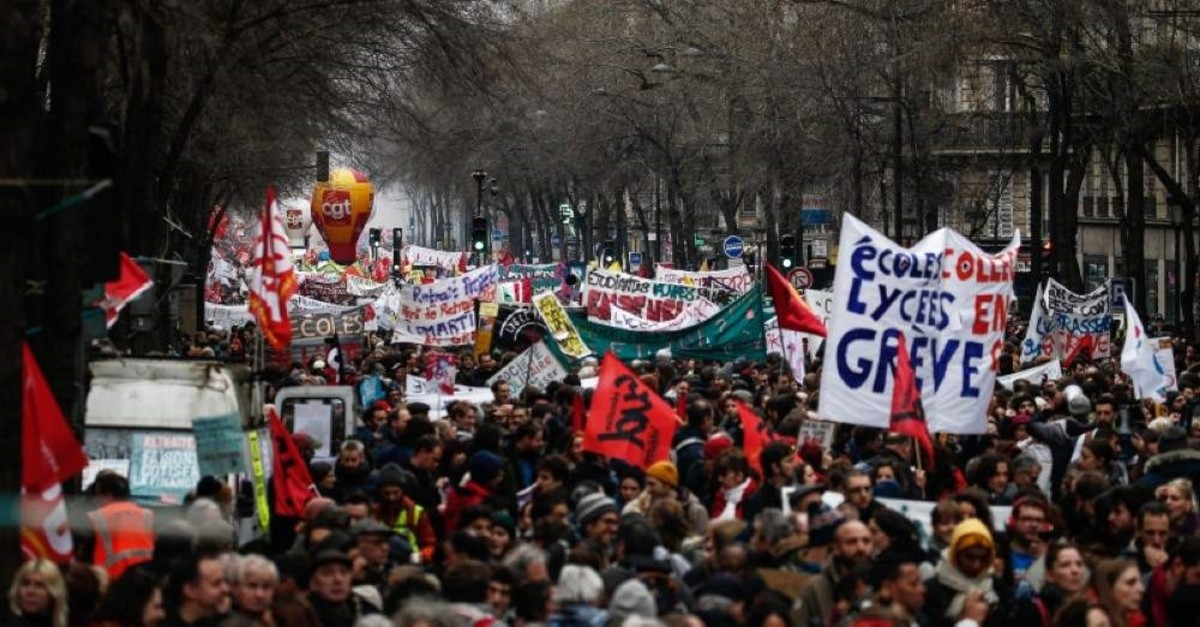 TOPSHOT - A picture shows a general view   during a demonstration in Paris, on January 9, 2020, on the 36th day of a nationwide multi-sector strike against French government's pensions overhaul. (Photo by Abdulmonam EASSA / AFP)