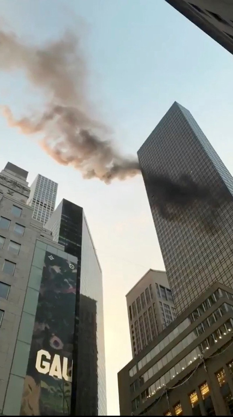 Smoke is seen rising from the roof of Trump Tower, in New York, U.S., January 8, 2018 in this still image obtained from social media video. (Reuters Photo)