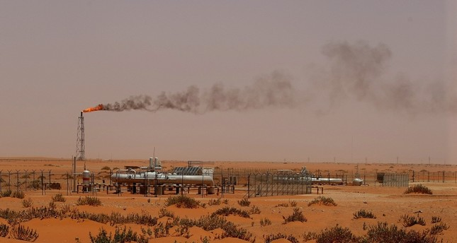 This June 23, 2008 photo shows a flame from a Saudi Aramco oil installation known as Pump 3 in the desert near the oil-rich area of Khouris, 160 km east of Riyadh, Saudi Arabia. (AFP Photo)