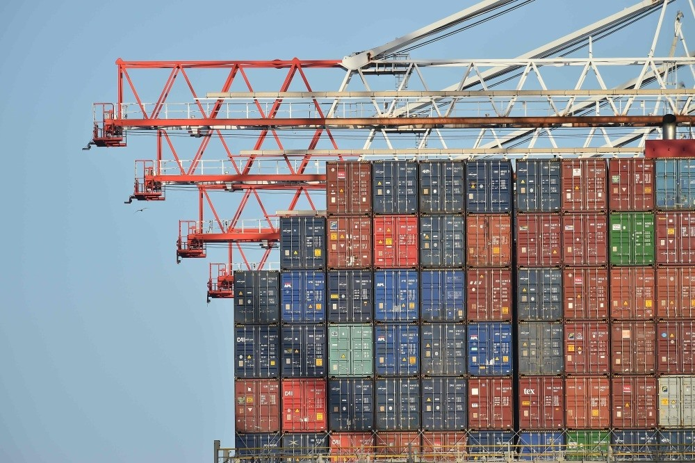 Containers aboard the container ship Benjamin Franklin as it is unloaded at Southampton Container Port, Southampton Docks, Southampton, southern U.K.