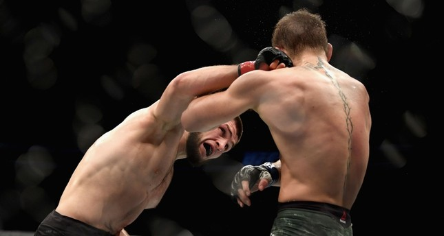 Khabib Nurmagomedov of Russia (L) punches Conor McGregor of Ireland in their UFC lightweight championship bout during the UFC 229 event inside T-Mobile Arena on October 6, 2018 in Las Vegas, Nevada. (AFP Photo)