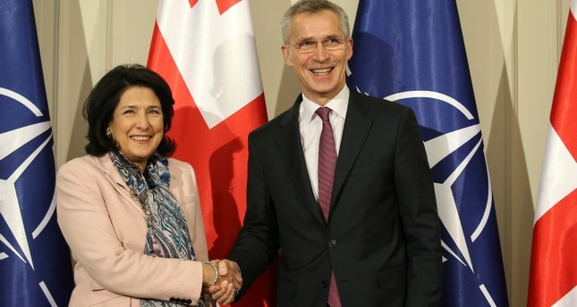 Georgian President Salome Zourabichvili shakes hands with NATO Secretary General Jens Stoltenberg during a meeting in Tbilisi, Georgia, March 25, 2019. Reuters Photo