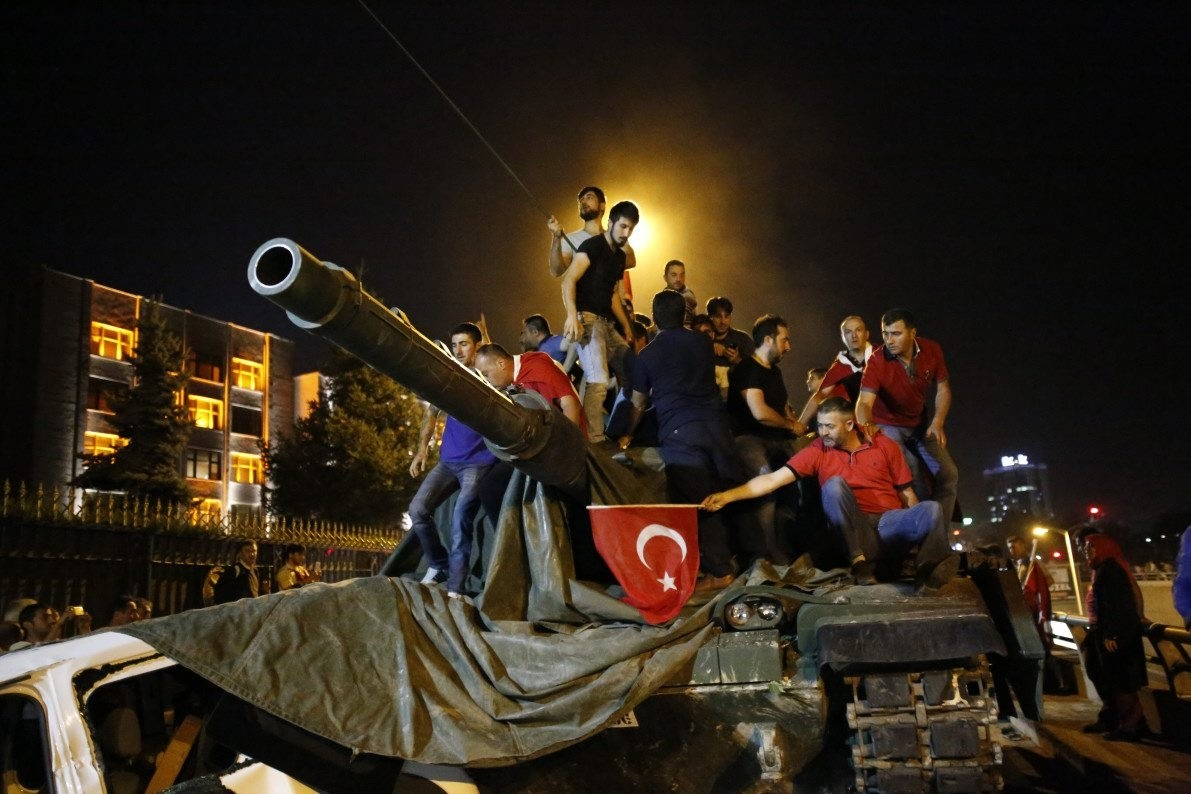 Anti-coup civilians stand on a tank controlled by putschist troops on July 15, 2016 during FETu00d6u2019s coup attempt.