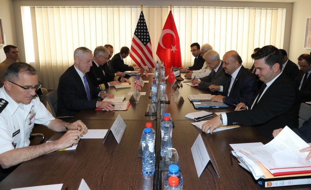 Defense Minister Fikri Iu015fu0131k (2nd R) with U.S. Secretary of Defense James Mattis (2nd L) at the NATO Defense Ministers Summit in Brussels, June 28.