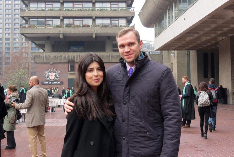 A handout photo taken in Jan. 2017 and released by Hedges family in London on Nov. 23 2018, shows British student Matthew Hedges (R) and his wife Daniela Tejada posing in London after Daniela's MA Graduation ceremony. (Photo by HO/Daniela Tejada/AFP)