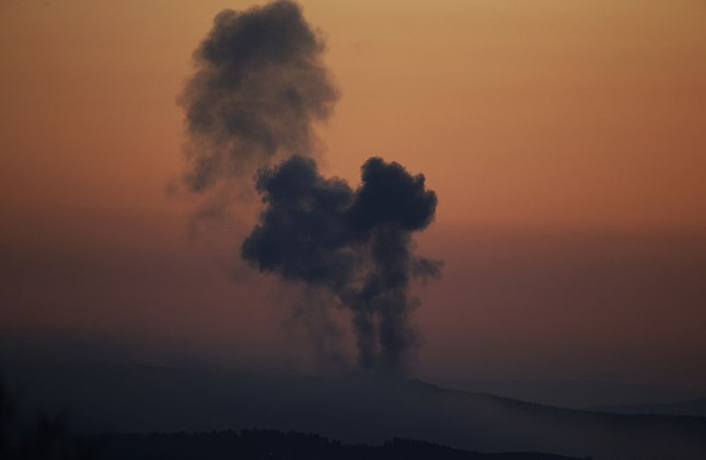 In this Saturday, Jan. 20, 2018 file photo, plumes of smoke rise on the air from inside Syria, as seen from the outskirts of the border town of Kilis, Turkey. (AP Photo)