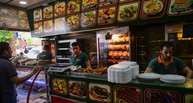 Syrian men work in a restaurant in Turkey's southeastern province of Gaziantep.