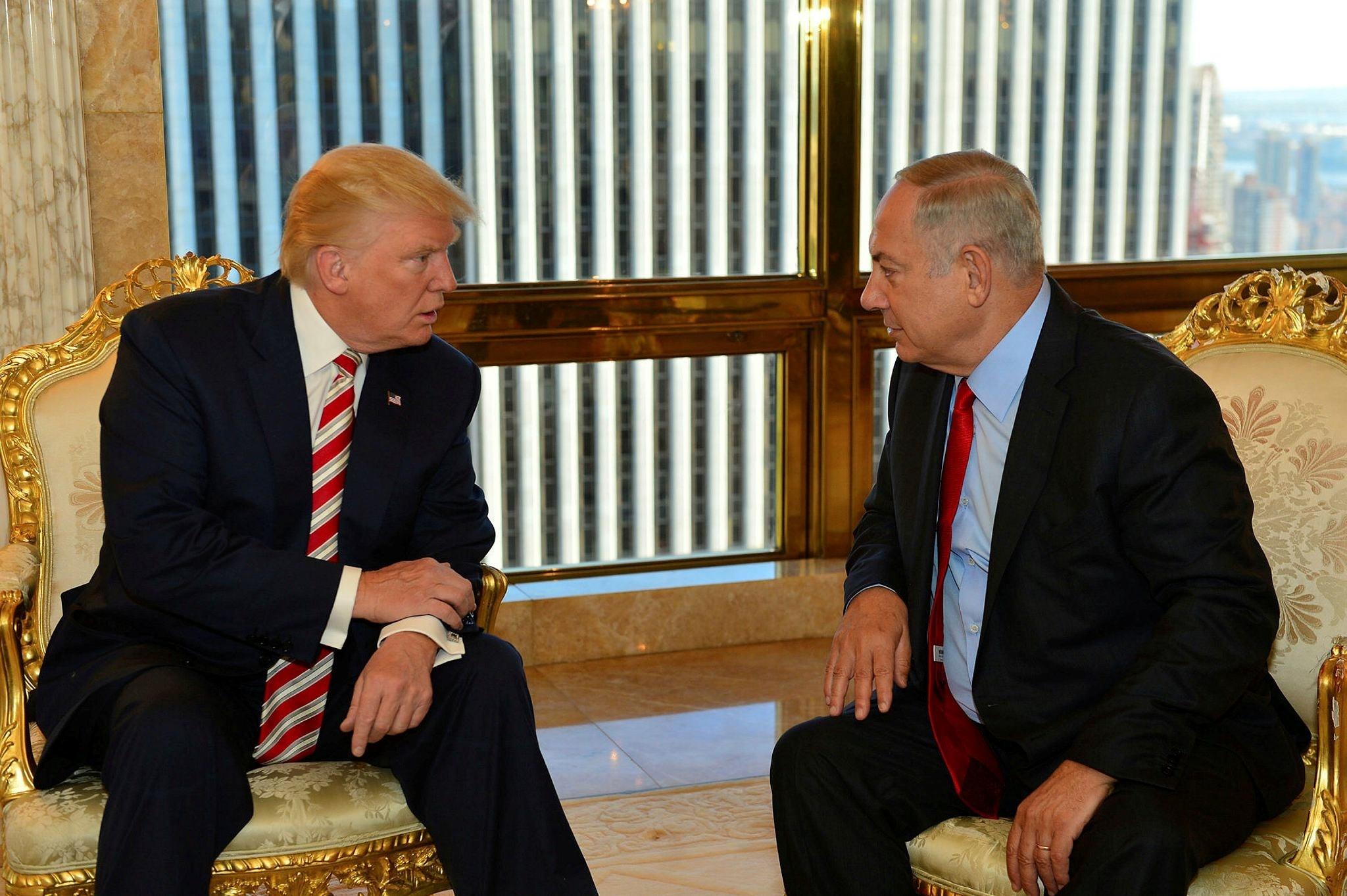 Israeli Prime Minister Benjamin Netanyahu speaks to U.S. President Donald Trump during their meeting in New York, Sept. 25.