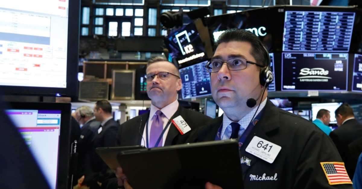 Traders Neil Catania, left, and Michael Capolino work on the floor of the New York Stock Exchange, Thursday, May 23, 2019. (AP Photo)