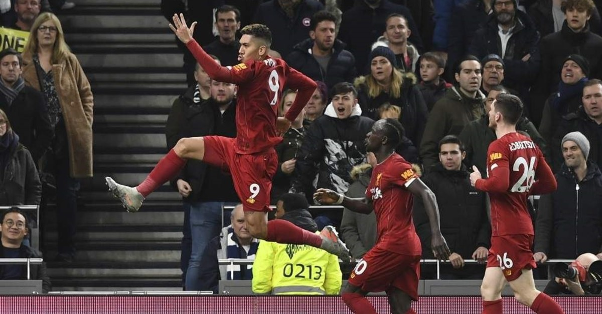 Liverpool players celebrate after scoring the opening goal against Tottenham in London, Jan. 11, 2020. (EPA Photo)