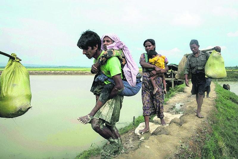 Displaced Rohingya refugees from Rakhine state walk near Ukhia, at the border between Bangladesh and Myanmar, Sept. 4.