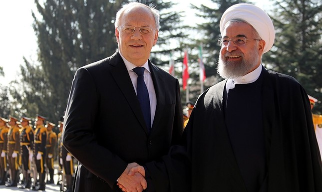 Iranian President Hassan Rouhani (R) shakes hands with his Swiss counterpart Johann Schneider in the capital Tehran in February 2016. (AFP Photo)