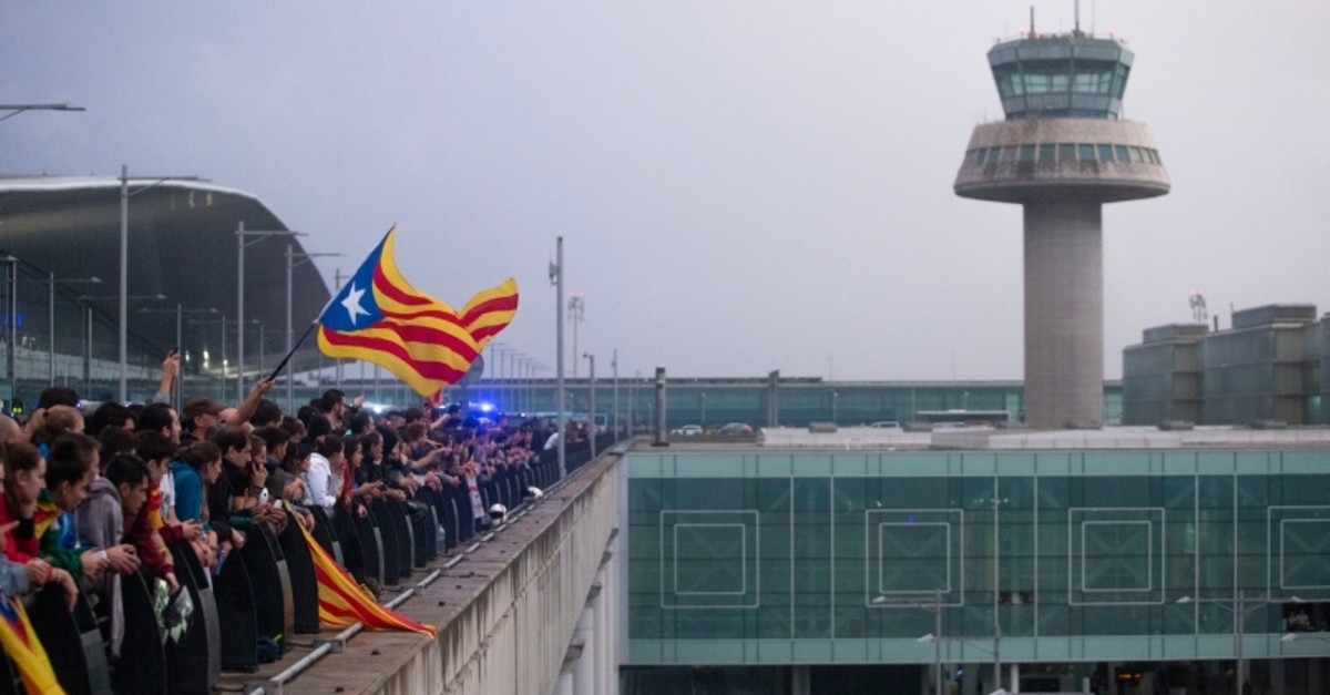 In this Monday, Oct. 14, 2019 photo, a protester waves an Estelada pro Catalonia independence flag during a demonstration at El Prat airport, outskirts of Barcelona, Spain. (AP Photo)