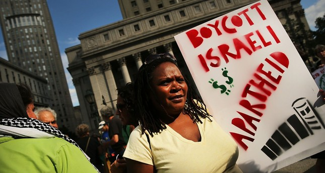 People protest against the Israeli state's military campaign in Gaza, in New York City, July 24, 2014.