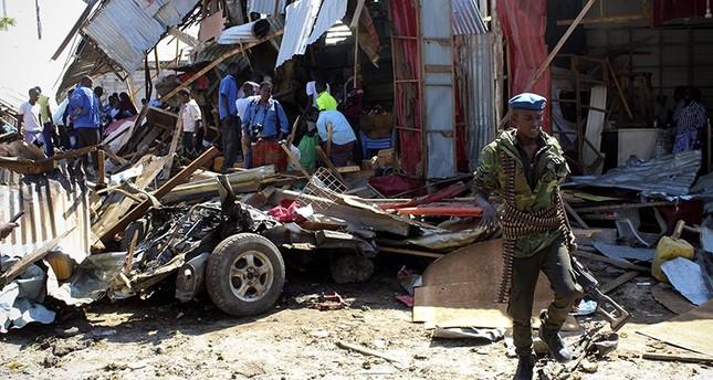 A security officer walks among rubble at the scene of a car bomb explosion near a market in Mogadishu, Somalia, Nov. 26, 2018. (EPA Photo)