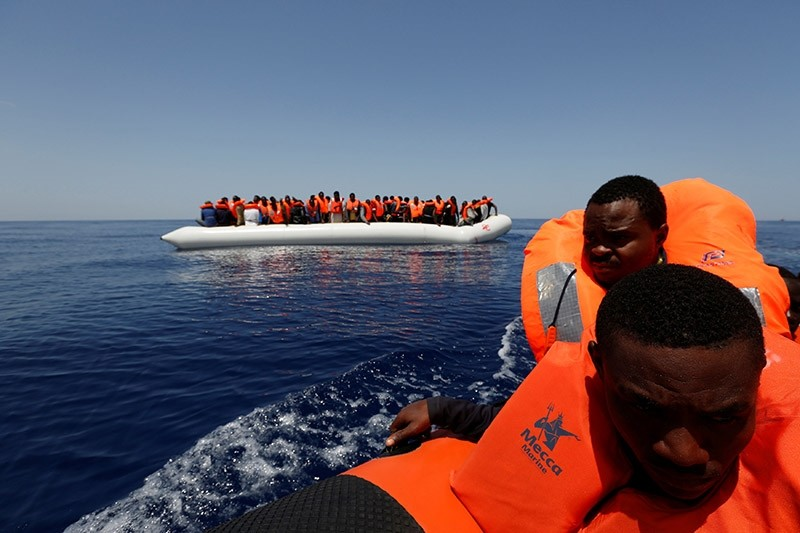 Migrants react after being rescued by the Malta-based NGO Migrant Offshore Aid Station (MOAS) ship Phoenix during a rescue operation in the central Mediterranean, in international waters off the Libya, May 4, 2017. (Reuters Photo)