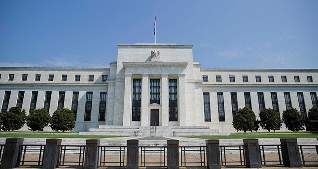 Fed raises interest rates, sees 3 rate hikes for 2018
