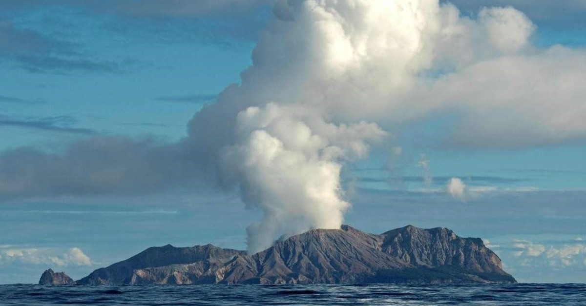This handout photo taken on July 23, 2019, and released to AFP courtesy of Chris Firkin on Dec. 9, 2019, shows the volcano on New Zealand's White Island spewing steam and ash. (AFP Photo)