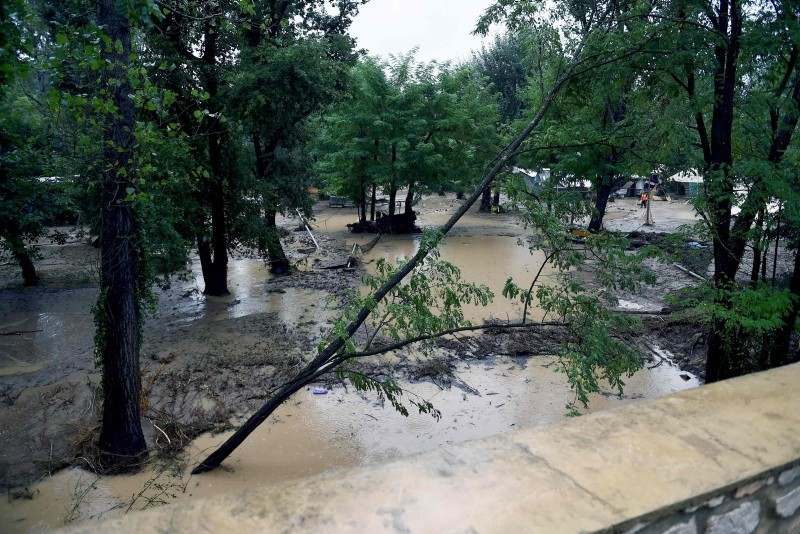 This picture shows a flooded and damaged camping as storms and heavy rains sweep across France on August 9, 2018 in Saint-Julien-de-Peyrolas, southern France. (AFP Photo)
