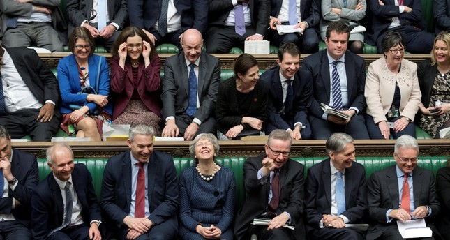 Britain's Prime Minister Theresa May reacts during the debate on extending the Brexit negotiating period in Parliament in London, March 14, 2019.