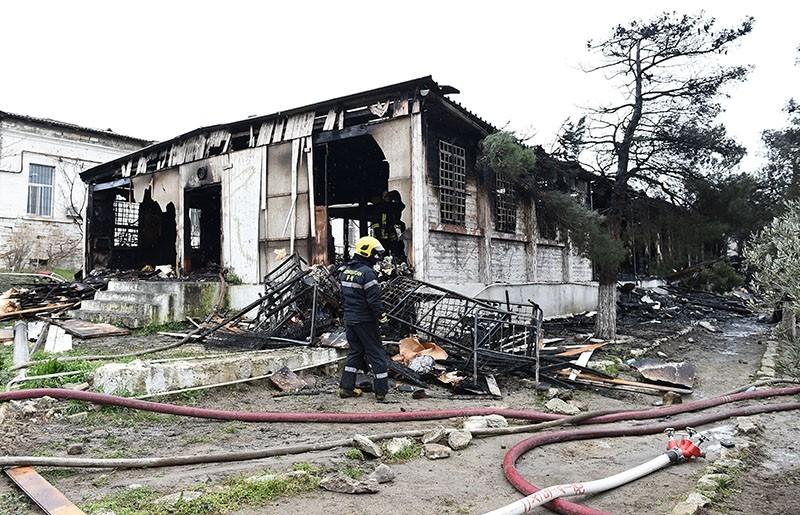 An Azerbaijani firefighter at the site of a fire in the republican drug rehabilitation center in Baku, Azerbaijan, March 02, 2018. (EPA Photo)