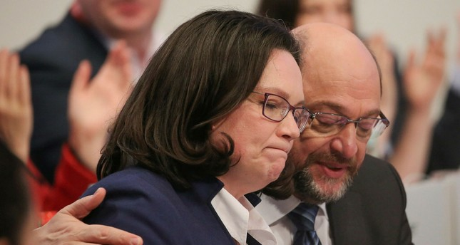 The leader of the Social Democratic Party's parliamentary faction, Andrea Nahles (L) and party leader Martin Schulz attend a party convention in Bonn, Jan. 21.