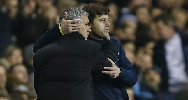 Tottenham manager Mauricio Pochettino, right, embraces Chelsea manager Jose Mourinho at the end of the Premier League match between Tottenham Hotspur and Chelsea at White Hart Lane Stadium in London, Jan. 1, 2015. (AP Photo)