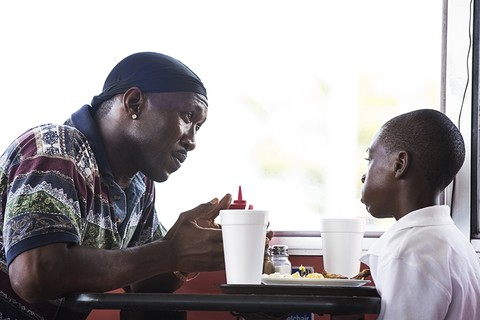 This image released by A24 Films shows Mahershala Ali, left, and Alex Hibbert in a scene from,