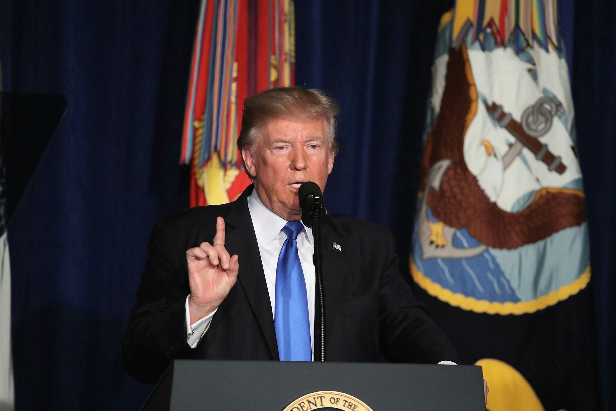 US President Donald J. Trump delivers remarks at the Fort Myer military base in Arlington, VA, August 21. (IHA Photo)