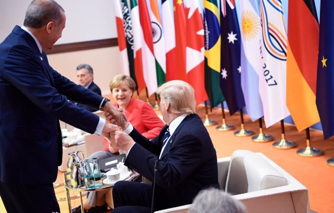 A handout photo made available by the German government on July 07, 2017 of US President Donald J. Trump (R) shaking hands with Turkish President Recep Tayyip Erdou011fan during the G20 leaders retreat meeting in Hamburg, Germany.