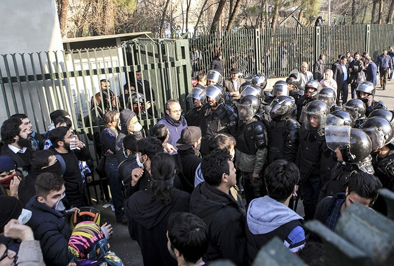 In this Dec. 30, 2017 file photo taken by an individual not employed by the AP and obtained by the AP outside Iran, anti-riot Iranian police prevent university students to join other protesters over Iran weak economy, in Tehran, Iran. (AP Photo)