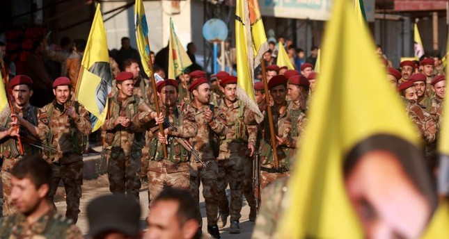 YPG terrorits demonstrate with flags and others bearing the portrait of PKK leader Abdullah Öcalan in the town of al-Muabbadah, Hassakah, Feb. 24.