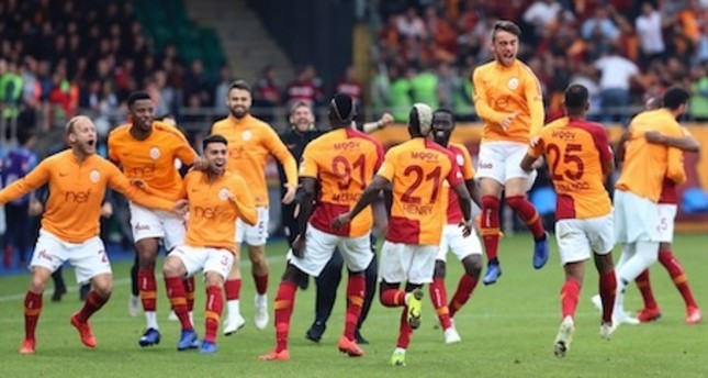 Galatasaray players  celebrate their late victory against Çaykur Rizespor after the match,  May 11, 2019.