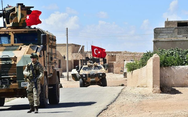 Turkish soldiers accompanied by armored vehicles patrolling near the city of Manbij, northern Syria as the Manbij operation continues with U.S. cooperation, June 18.