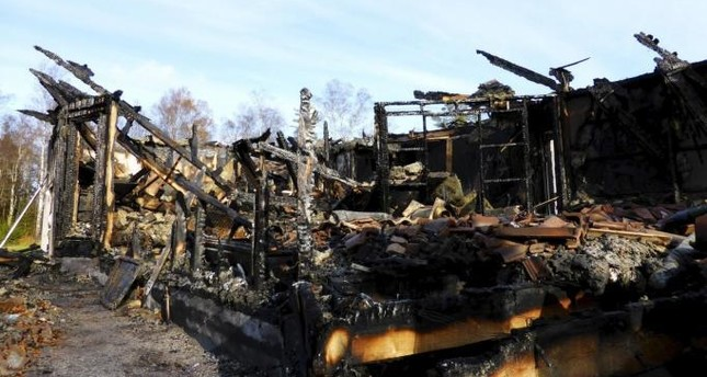 A burned down asylum centre is seen in Munkedal, Sweden October 27, 2015. (REUTERS Photo)