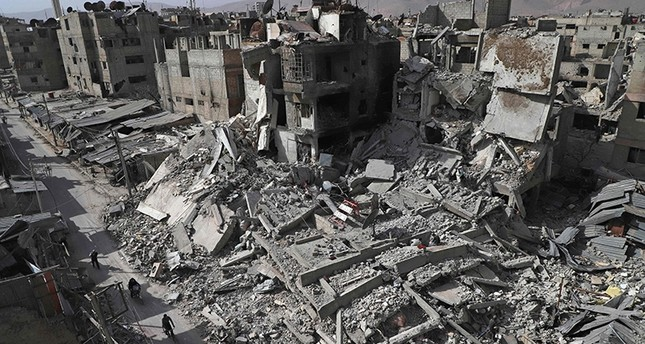 A general view shows several destroyed buildings in Douma, in the opposition enclave of eastern Ghouta on the outskirts of Damascus (AFP Photo)