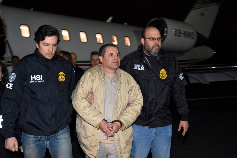 In this Jan. 19, 2017 file photo provided U.S. law enforcement, authorities escort Joaquin ,El Chapo, Guzman, center, from a plane to a waiting caravan of SUVs at Long Island MacArthur Airport in Ronkonkoma, N.Y. (AP Photo)