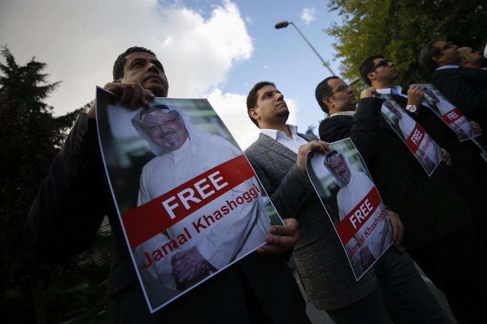 Demonstrators hold posters with photos of the missing Saudi national and slogans reading ,Free Jamal Khashoggi,, Oct. 5.