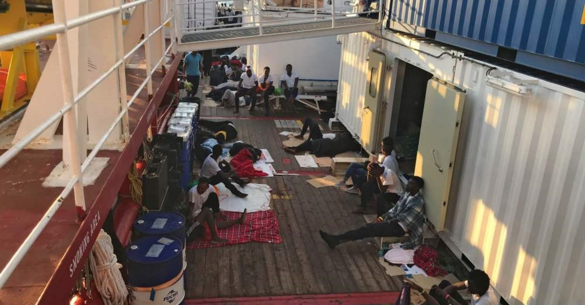 Rescued migrants rest on the deck of the Ocean Viking rescue ship in the Mediterranean Sea, Aug. 12, 2019.