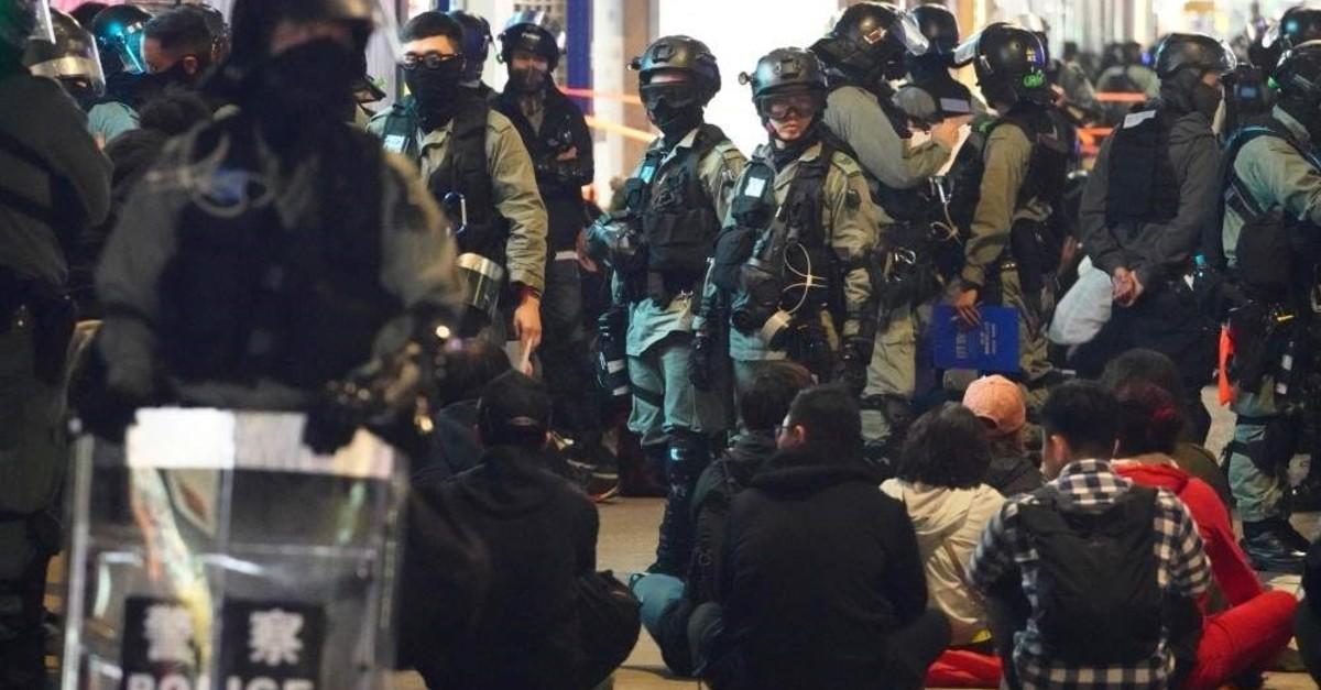 Police detain protesters, Hong Kong, Jan. 1, 2020. (AP Photo)